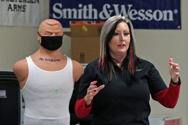 Christine Trivette conducts a concealed carry course Feb. 1, at Shooter Express in Belmont.
