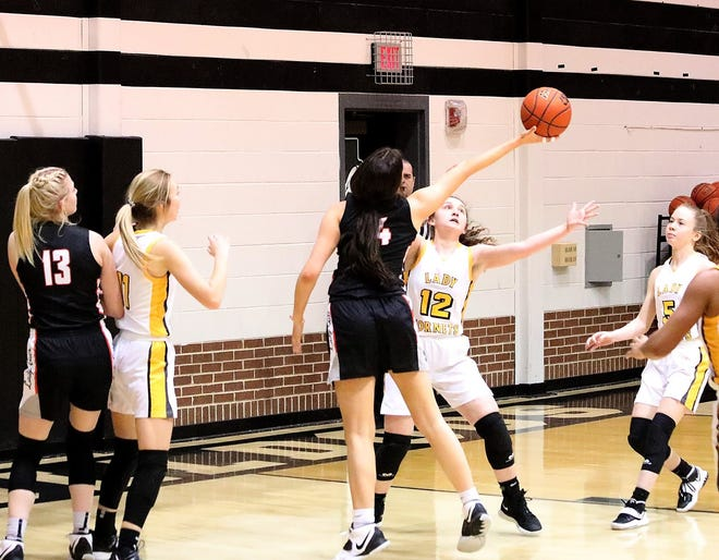 Tom Bean's Kaitlyn Lind goes for a rebound over Era's Bailee Bowden in a 2A Region II bi-district contest at Howe.