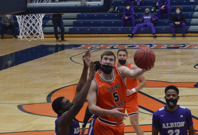 Hope College's Ryan Gamm puts up a shot against Albion.