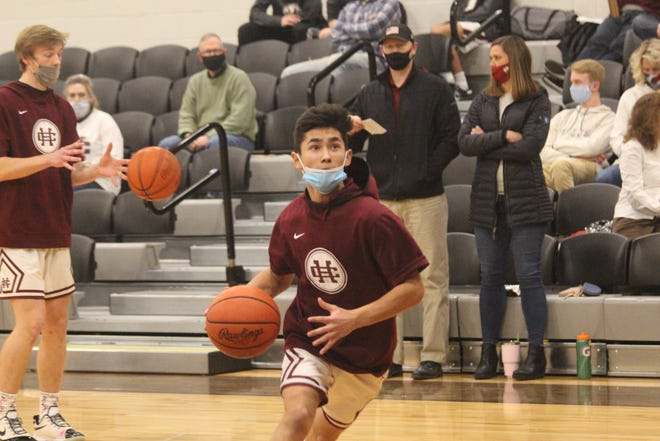 Holland Christian boys basketball won big on Friday night over Fruitport to get brad Jansen his first win at the helm of the Maroons