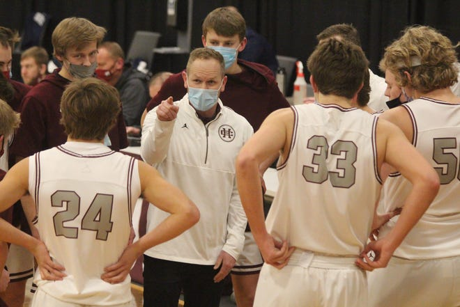 Holland Christian boys basketball coach Brad Jansen speaks with his team in between quarters during their win over Fruitport on Friday, Feb 12, 2021