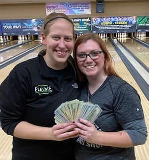 Hailey Jepson (L) and Nicole Hartseil show of winnings after claiming February Doubles title at Landmark Lanes.