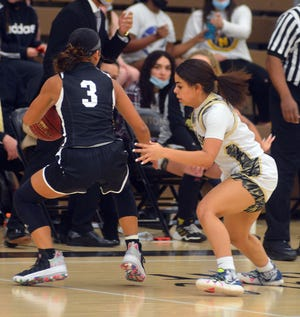 Newton senior Lexi Valle-Ponds guards Maize South sophomore Piper McCann during play Friday.