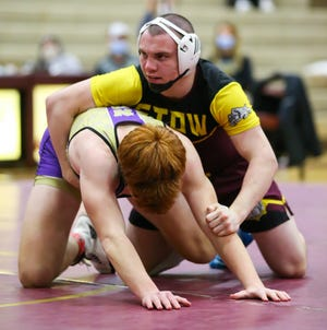 Stow-Munroe Falls 182-pounder Will Edmonson holds down North Royalton's Jack Haley during their match Thursday at Stow.