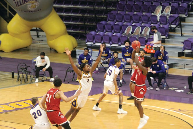 Tamell Pearson attempts to block a shot during Friday night's game against Denver.