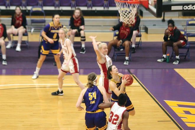 Grace Gilmore goes up for a basket against Denver.