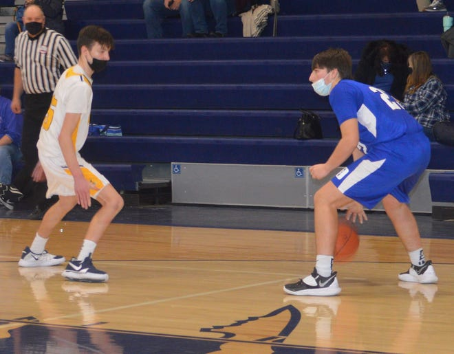 Drew Bolster looks to pass over the Whiteford press in the fourth quarter Saturday afternoon. Bolster made three of four free throws down the stretch as Dundee held off Whiteford 51-47. [Photo by DOUG DONNELLY]