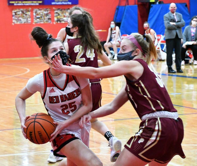 Spaulding's Hannah Drew, left, drives to the basket on Portsmouth's Caitlin McDonough during this Division I girls basketball game Friday in Rochester