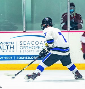 Oyster River's Aiden Swiesz prepares to unleash a shot on net in Friday's Division II boys hockey game against Portsmouth/Newmarket at Dover Ice Arena. Swiesz had a hat trick in his team's 8-1 win.