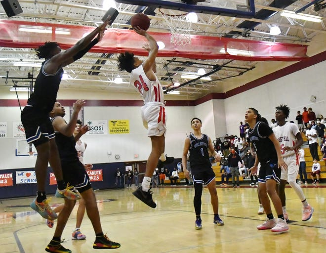 Forest Hill junior Braysor Martinez rises for the game-winning lay-up against Wellington. The shot came with just six seconds left to play, clinching the come-from-behind 68-67 victory for the Falcons.
