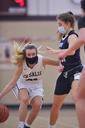 Mackenzie Grover and the La Salle girls basketball team travels to take on St. Raphael tonight in a big Division I battle.
