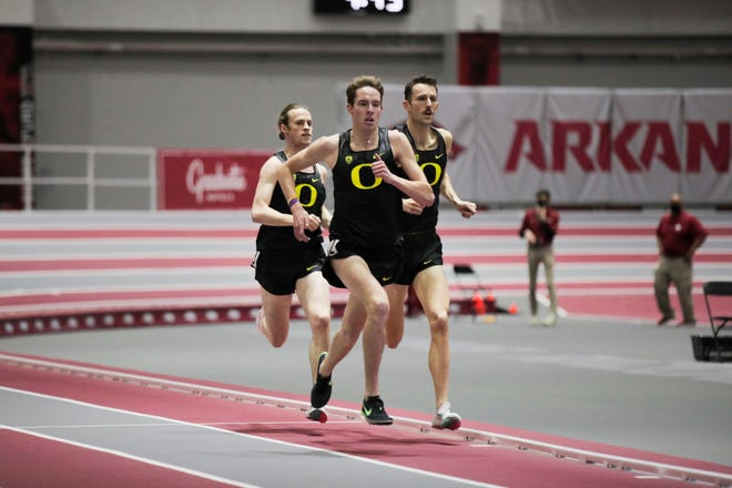 Oregon's Cooper Teare, Cole Hocker (left) and Charlie Hunter (right) race into the record books in the men's mile Friday.