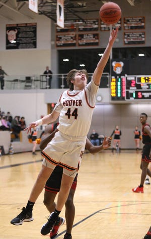 Tanner Ware of Hoover takes an inside shot during their game against McKinley at Hoover on Friday, Feb. 12, 2021.