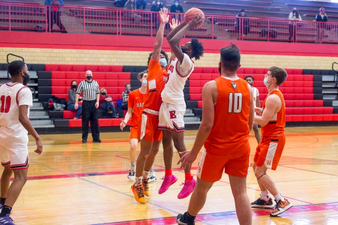 "Makarious ""Biggie"" Luster, shown scoring against Harlem on Feb. 13, was named NIC-10 boys MVP after leading East to its second conference title in three years."