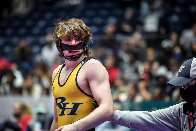 Richmond Hill's Tate Evans bloodied his nose while wrestling Wheeler's Zayn Hall in the finals of the 170-pound Division at the GHSA Class 6A traditional wrestling state tournament this season at the Macon Centreplex. Evans won the title by an 8-5 decision.