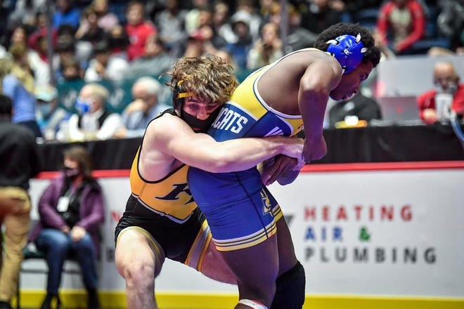 Richmond Hill's Tate Evans wrestles Wheeler's Zayn Hall in the finals of the 170-pound division at the GHSA Class 6A traditional wrestling state tournament on Friday at the Macon Centreplex. Evans won the title with an 8-5 decision.