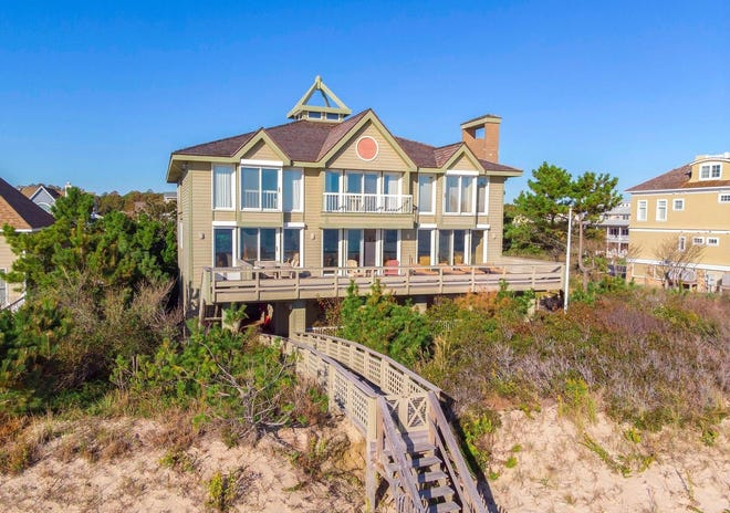 This oceanfront home at 30073 Surfside Drive, Bethany Beach, features 8 bedrooms and 8 baths.