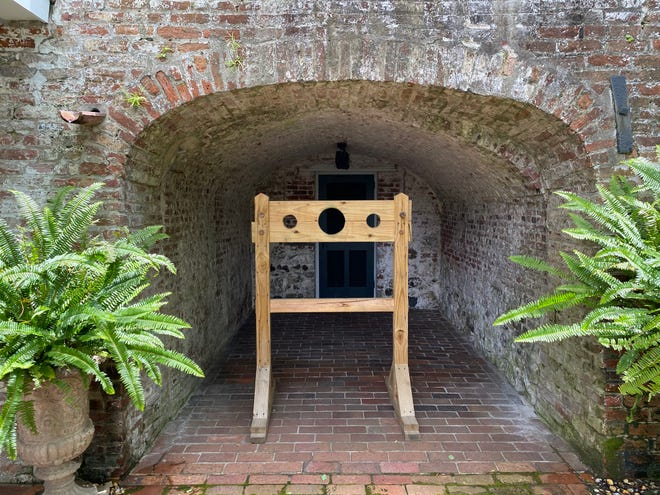 A recreated stocks and pillory sits inside one of the preserved jail cells at the Burgwin-Wright House, which is built on the remnants of Wilmington's first jail.
