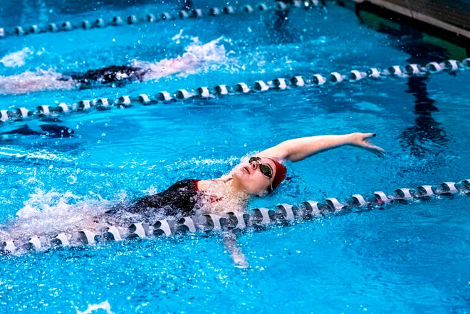 New Bedford's Cynthia Torres lunges forward as she closes in on the finish line of the 100 backstroke earlier this season. She won the 100 freestyle in Thursday's conference championship.