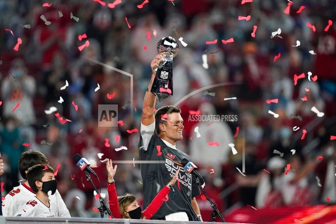 Tampa Bay Buccaneers quarterback Tom Brady holds up the Vince Lombardi trophy after defeating the Kansas City Chiefs in Super Bowl 55.