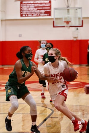 NFA senior guard Sarah Ericson drives to the basket against New London on Friday night at Alumni Gymnasium.