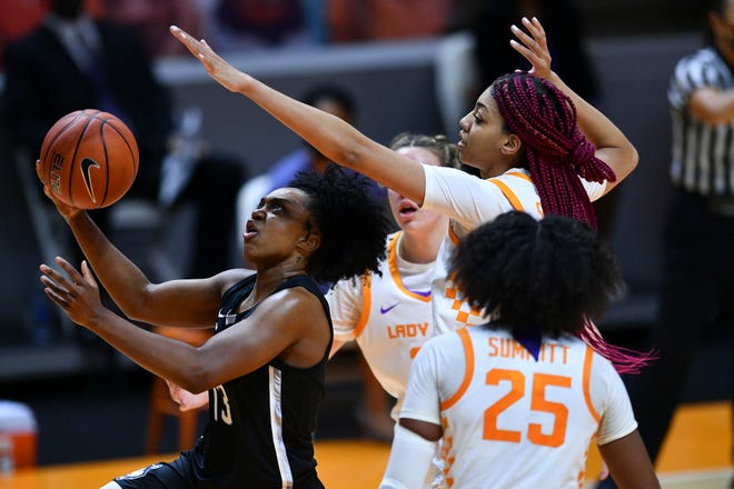 Connecticut's Christyn Williams (13) shoots during the Huskies' win against Tennessee in Knoxville, Tenn.