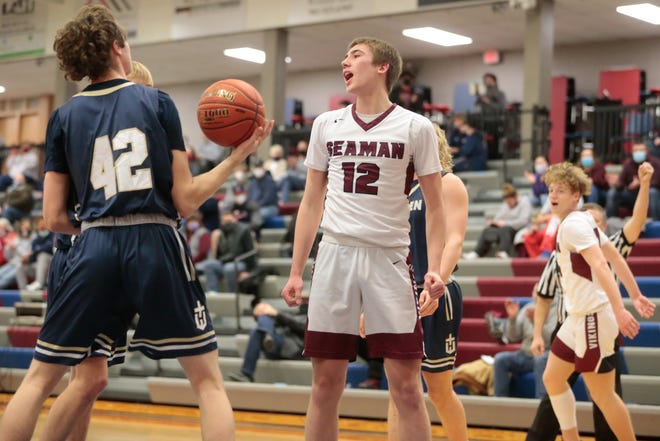 Seaman's Ty Henry yells out after scoring a basket during the first half of Friday's game against Hayden. Henry scored 11 as the Vikings routed Hayden 53-27.