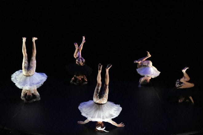 """Dancers, from left to right, Joaquin Medina Caligari from Uruguay, Tasha Petersen from Argentina, Valentino Martinetti from Argentina, Marius Fouilland from France and Lucille Chalopin from Paris, of the Eolienne company perform """"Le Lac des Cygnes"""" by Florence Caillon, based on Tchaikovsky's Swan Lake during the BIAC, International Circus Arts Biennale Feb. 4 in Marseille, France."""