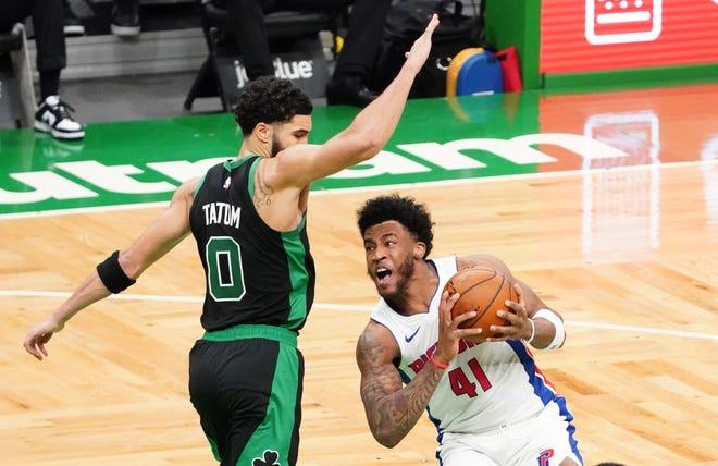 Pistons forward Saddiq Bey (41) drives the ball past Celtics forward Jayson Tatum during the third quarter.