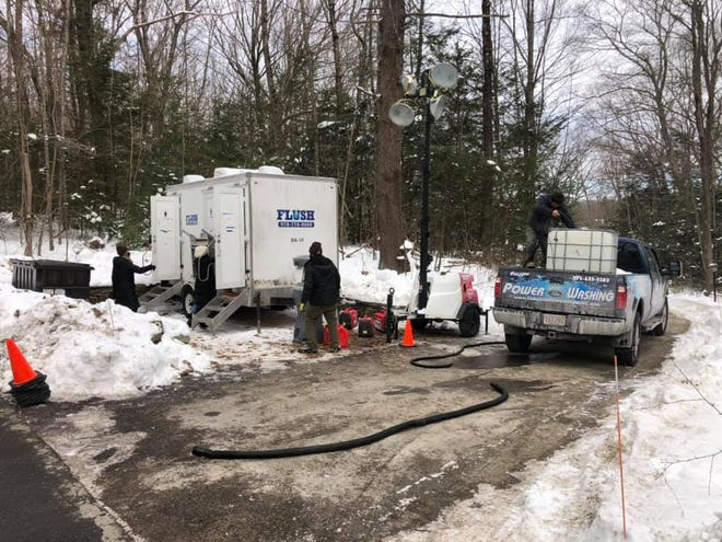 """A crew from Paragon Power Washing delivers water to the portable toilets on the set of """"Dexter"""" on Leadmine Road in Sturbridge Friday."""