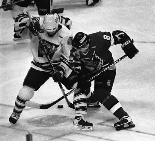 The IceCats' Stephane Roy battles for the puck with the Springfield Falcons' Daniel Briere during a game in December 1997.