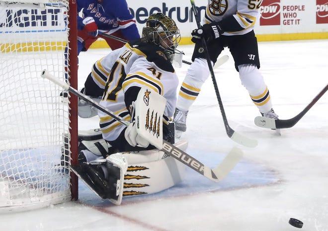 Bruins goaltender Jaroslav Halak turns aside a shot Friday night while posting a shutout at Madison Square Garden.