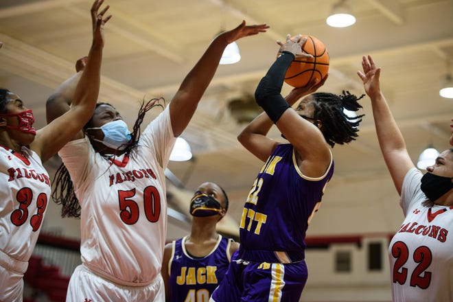 Jack Britt's Ashara Hayes (22) notched a double-double in a rout of Seventy-First to help the Bucs claim the regular-season title in the Sandhills 4-A Conference for the second year in a row.