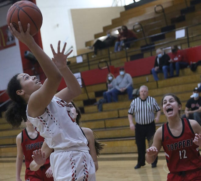 New Philadelphia's Ajia Schreffler shoots with Chardon's Kayla Noerr defending in the Division I Girls Sectional Basketball Tourmanent Saturday.