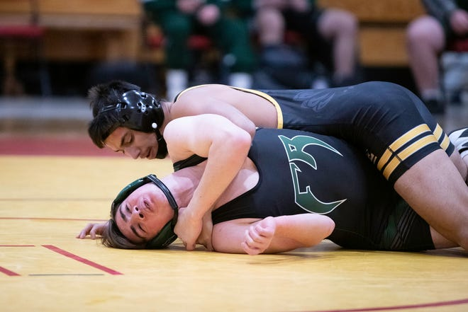 East High School's Anthony Flores earns backpoints on Fossil Ridge's Justin Webb-Isabela during their 145-pound matchup at the Coronado quad on Saturday February 13, 2021.