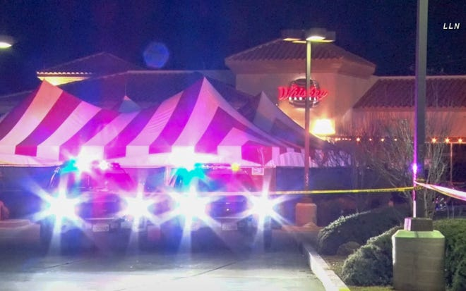 Crime scene tape and sheriff's vehicle cordons off the parking lot near the Whiskey Barrel in Hesperia on Saturday, Feb. 13, 2021. A shooting outside the bar left one person dead and two injured, authorities said.