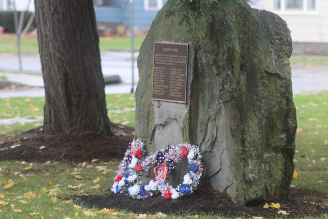 Memorial Park adorned with wreaths on Memorial Day in Wellsville.