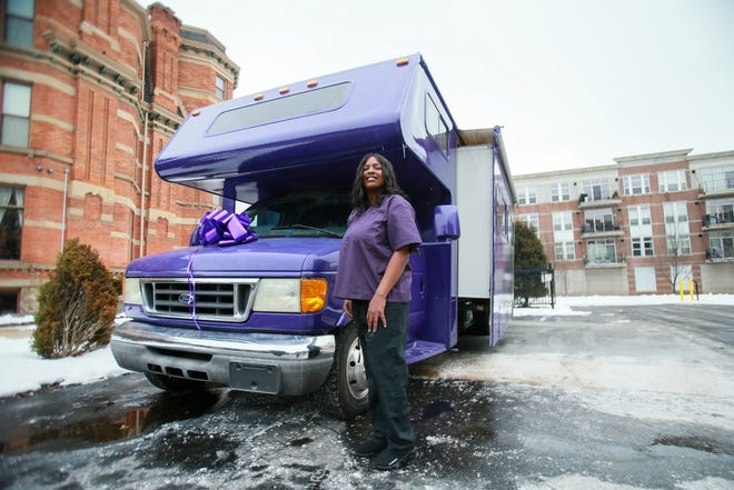 Brandy Ali poses for a portrait in front of her newly opened Spa Land mobile spa on Feb. 12, 2021, in Detroit. The camper was converted to bring her spa services to her customers, rather than have them come to her.