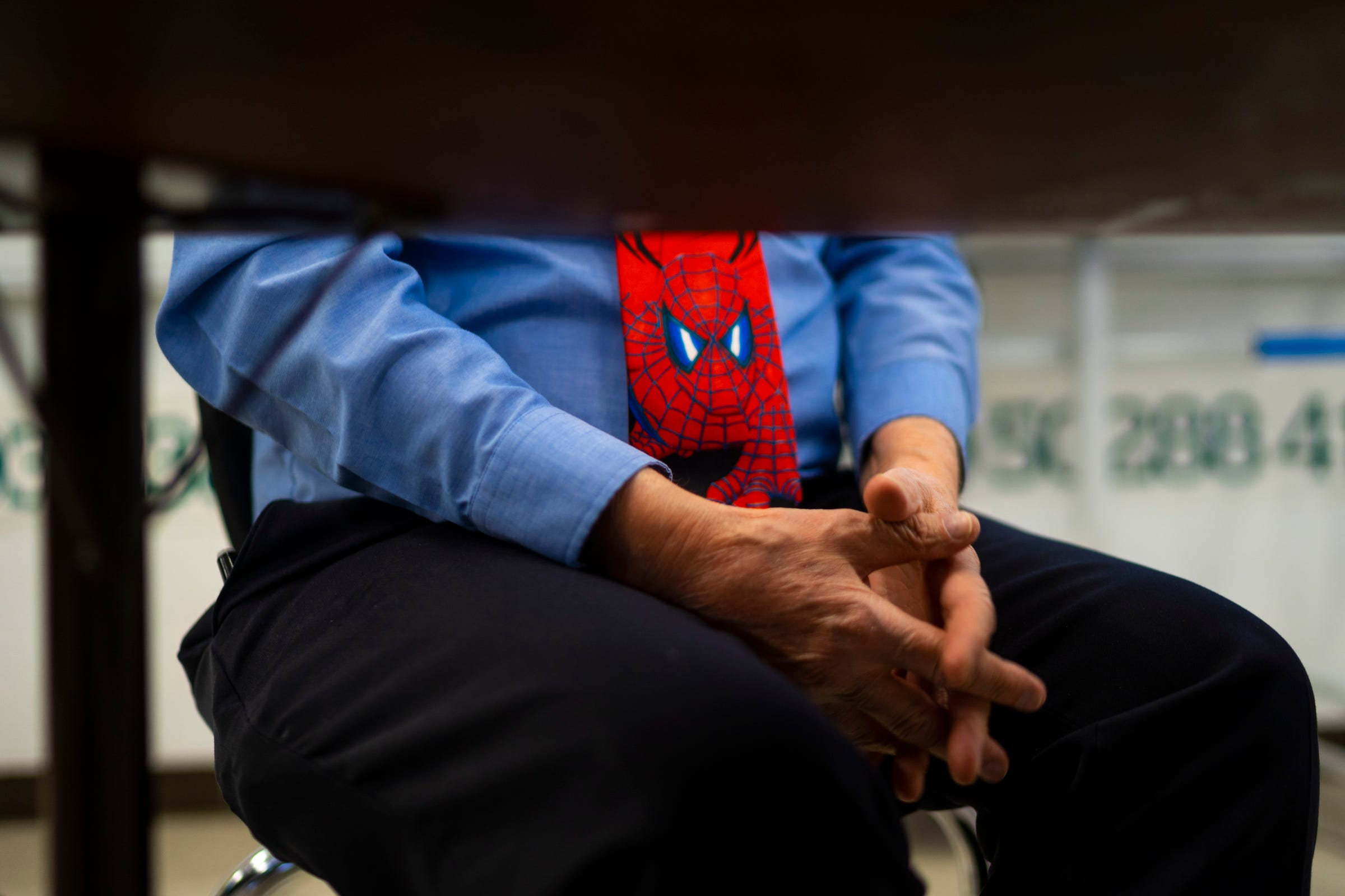 """Christopher Holstein wears a Spider-Man themed tie while participating in a virtual practice for an upcoming competition in the Academic Games on Feb. 4, 2021 at Bates Academy in Detroit. He wears similar ties because it gets fun reactions out of his students. Holstein, an educator of 52 years, is celebrating his 45th year as an Academic Games coach. """"It keeps me going,"""" Holstein said regarding the Academic Games."""
