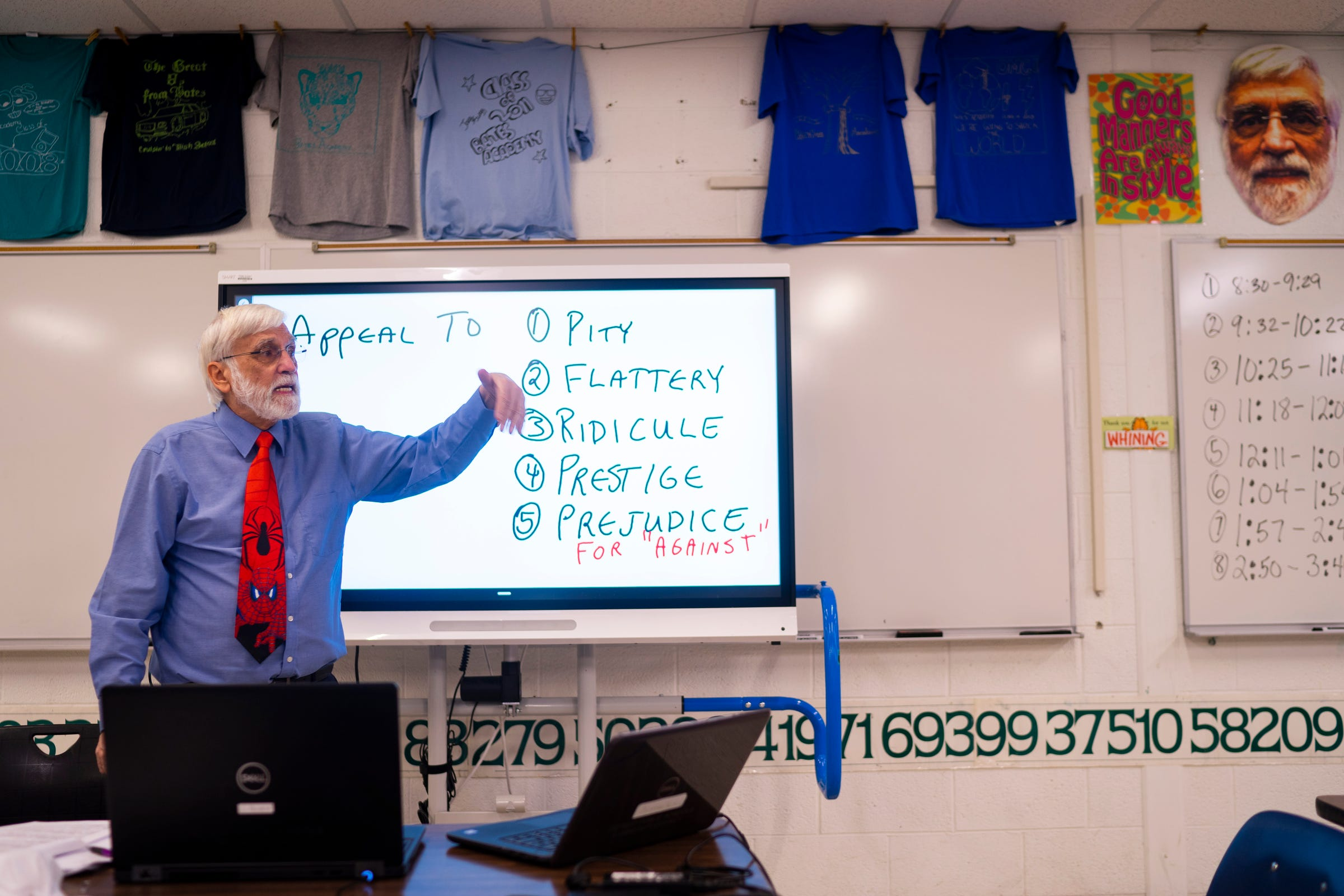 """Christopher Holstein discusses segments of propaganda techniques during a virtual practice for an upcoming competition in the Academic Games on Feb. 4, 2021 at Bates Academy in Detroit. Holstein, an educator of 52 years, is celebrating his 45th year as an Academic Games coach. """"It keeps me going,"""" Holstein said regarding the Academic Games."""