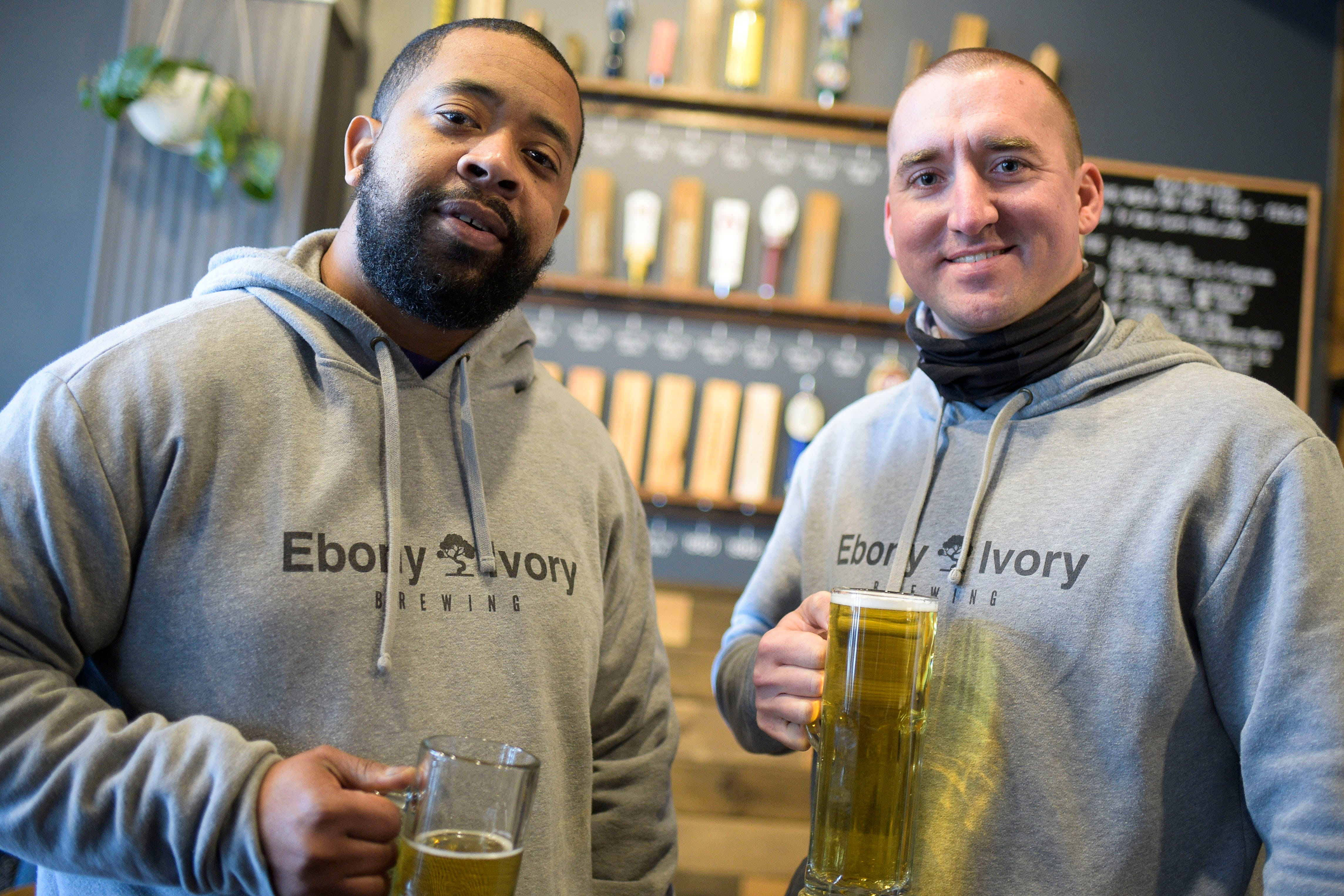 Ebony Ivory Brewing owners Chico Dupas, left, and Mitchell Russell pose for a portrait at Knox Brew Hub in downtown Knoxville, Tenn. on Saturday, Feb. 13, 2021.