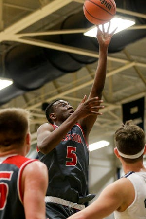 West Lafayette's Divine Adeyanju (5) goes up for a layup during the fourth quarter of an IHSAA boys basketball game, Friday, Feb. 12, 2021 in Lafayette.