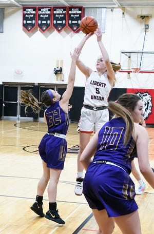 Liberty Union's Abbie Riddle shoots a jump shot against visiting Bloom-Carroll Friday night. The Lions prevailed 33-31. -Jamie Potts/Eagle Gazette
