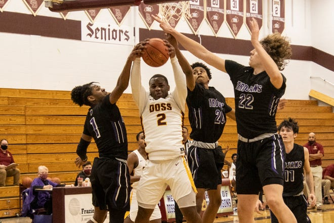 Doss High point guard Cori Toole goes up hard for the rebound against the Southern defense on Friday night. 2/12/21