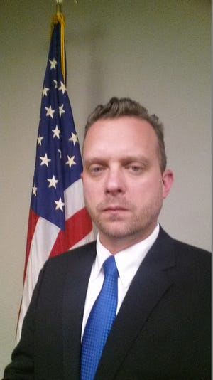 Joseph Michael Gill, then a DEA special agent, was lauded in a Nogales International news report on the Nogales Rotary Club's 2015 awards ceremony for outstanding lawmen
