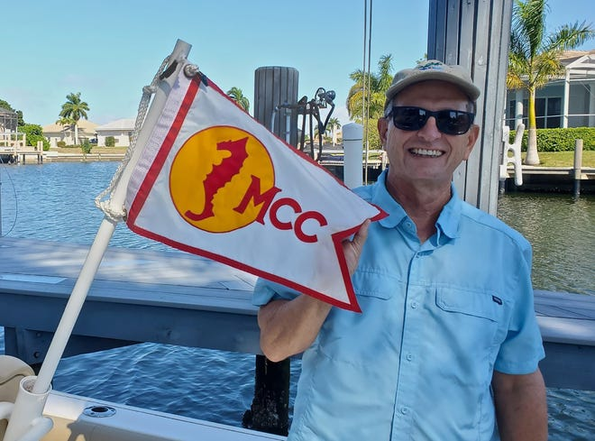 Commodore Todd Whitney proudly displays MCC Burgee.