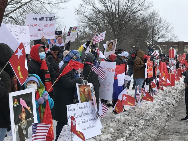 More than 100 people, many of them Burmese refugees, line the sidewalk on the western edge of Mitchell Park in Milwaukee on Feb. 6 to protest the military coup in Myanmar, also known as Burma, earlier that week.