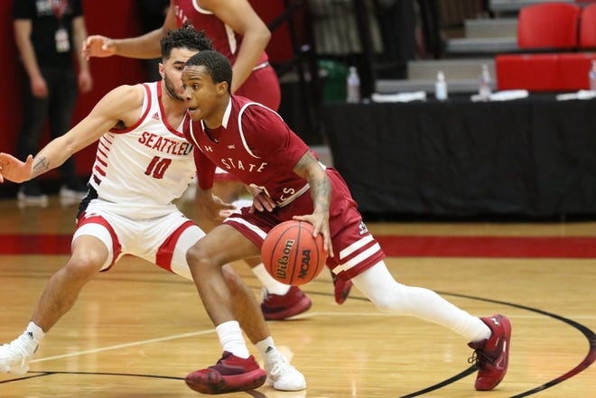 Senior guard Evan Gilyard II drives past his defender during New Mexico State's game against Seattle on Feb. 12, 2021, in Seattle, Washington.