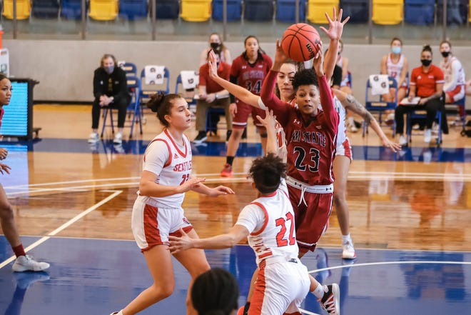Aaliyah Prince (23) passes as the New Mexico State Women's basketball team faces off against Seattle University at Eastwood High School in El Paso on Saturday, Feb. 13, 2021.