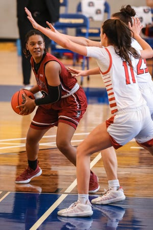 Adrianna Henderson (10) looks to pass as the New Mexico State Women's basketball team faces off against Seattle University at Eastwood High School in El Paso on Saturday, Feb. 13, 2021.